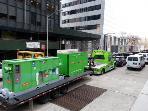 On December 1, we took a walk all the way downtown, walking downtown by the Hudson River and part way up through the Financial District. The first signs that things were still amiss were these green generators and men in white hazmat suits.