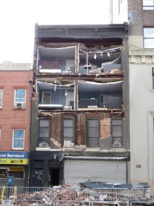 The front fell off this building just above 14th Street on Eighth Avenue. 2012-11-01